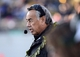 Nov 9, 2013; Annapolis, MD, USA; Hawaii Warriors head coach Norm Chow talks on his headset on the sidelines during the first quarter of the Hawaii Warriors vs Navy Midshipmen game at Navy Marine Corps Memorial Stadium. Mandatory Credit: Tommy Gilligan-USA TODAY Sports