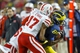 Nov 9, 2013; Ann Arbor, MI, USA; Nebraska Cornhuskers cornerback Ciante Evans (17) and safety Corey Cooper (6) tackle Michigan Wolverines tight end Jake Butt (88) in the third quarter at Michigan Stadium. Mandatory Credit: Rick Osentoski-USA TODAY Sports