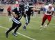 Nov 9, 2013; Durham, NC, USA; Duke Blue Devils quarterback Anthony Boone (7) scrambles against North Carolina State Wolfpack as he looks downfield at Wallace Wade Stadium. Mandatory Credit: Mark Dolejs-USA TODAY Sports