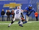 Nov 9, 2013; Memphis, TN, USA; Memphis Tigers wide receiver Joe Craig (2) carries the ball against Tennessee Martin Skyhawks defensive back Kevin Barfield (6) during the second quarter at Liberty Bowl Memorial. Mandatory Credit: Justin Ford-USA TODAY Sports