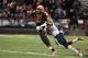 Nov 9, 2013; College Park, MD, USA; Maryland Terrapins quarterback C.J. Brown (16) is pressured by Syracuse Orange linebacker Marquis Spruill (11) at Byrd Stadium. Mandatory Credit: Mitch Stringer-USA TODAY Sports