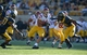 Nov 9, 2013; Berkeley, CA, USA; Southern California Trojans tailback Ty Isaac (29) carries the ball as California Golden Bears cornerback Cedric Dozier (37) and safety Cameron Walker (14) defend at Memorial Stadium. USC defeated California 62-28. Mandatory Credit: Kirby Lee-USA TODAY Sports