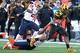 Nov 9, 2013; College Park, MD, USA; Maryland Terrapins running back Brandon Ross (45) runs past Syracuse Orange safety Durell Eskridge (3) at Byrd Stadium. Mandatory Credit: Mitch Stringer-USA TODAY Sports