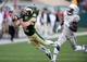 Nov 9, 2013; Fort Collins, CO, USA; Colorado State Rams wide receiver Thomas Coffman (2) pulls in a reception as Nevada Wolf Pack defensive back Kaodi Dike (16) defends in the fourth quarter at Hughes Stadium. The Rams defeated the Wolf Pack 38-17.Mandatory Credit: Ron Chenoy-USA TODAY Sports