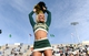 Nov 9, 2013; Fort Collins, CO, USA; Colorado State cheerleader performs in the second quarter against the Nevada Wolf Pack at Hughes Stadium. The Rams defeated the Wolf Pack 38-17. Mandatory Credit: Ron Chenoy-USA TODAY Sports