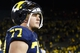 Nov 9, 2013; Ann Arbor, MI, USA; Michigan Wolverines offensive linesman Taylor Lewan (77) walks off the field after the game against the Nebraska Cornhuskers at Michigan Stadium. Nebraska won 17-13. Mandatory Credit: Rick Osentoski-USA TODAY Sports