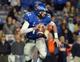 Nov 9, 2013; Memphis, TN, USA; Memphis Tigers quarterback Paxton Lynch (12) scrambles against Tennessee Martin Skyhawks during the third quarter at Liberty Bowl Memorial. Mandatory Credit: Justin Ford-USA TODAY Sports