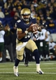 Nov 9, 2013; Annapolis, MD, USA; Navy Midshipmen quarterback Keenan Reynolds (19) runs in the open field with the ball during the third quarter at Navy Marine Corps Memorial Stadium. Navy defeated Hawaii 42-38 Mandatory Credit: Tommy Gilligan-USA TODAY Sports