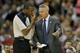 Nov 9, 2013; Cleveland, OH, USA; Philadelphia 76ers head coach Brett Brown (right) talks to referee Sean Wright in the second quarter against the Cleveland Cavaliers at Quicken Loans Arena. Mandatory Credit: David Richard-USA TODAY Sports