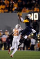 Nov 9, 2013; Morgantown, WV, USA; West Virginia Mountaineers wide receiver Kevin White (11) jumps to try to catch a pass over Texas Longhorns cornerback Duke Thomas (21) at Milan Puskar Stadium. Mandatory Credit: Evan Habeeb-USA TODAY Sports