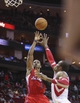 Nov 9, 2013; Houston, TX, USA; Los Angeles Clippers point guard Chris Paul (3) shoots during the fourth quarter as Houston Rockets center Dwight Howard (12) defends at Toyota Center. Mandatory Credit: Troy Taormina-USA TODAY Sports