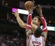 Nov 9, 2013; Houston, TX, USA; Los Angeles Clippers power forward Blake Griffin (32) takes the ball to the basket during the fourth quarter as Houston Rockets center Dwight Howard (12) defends at Toyota Center. The Clippers defeated the Rockets 107-94. Mandatory Credit: Troy Taormina-USA TODAY Sports