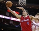 Nov 9, 2013; Houston, TX, USA; Los Angeles Clippers shooting guard J.J. Redick (4) takes the ball to the basket during the third quarter as Houston Rockets center Omer Asik (3) defends at Toyota Center. The Clippers defeated the Rockets 107-94. Mandatory Credit: Troy Taormina-USA TODAY Sports