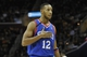 Nov 9, 2013; Cleveland, OH, USA; Philadelphia 76ers small forward Evan Turner (12) reacts in the third quarter against the Cleveland Cavaliers at Quicken Loans Arena. Mandatory Credit: David Richard-USA TODAY Sports
