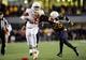 Nov 9, 2013; Morgantown, WV, USA; Texas Longhorns running back Malcolm Brown (28) gives a stiff arm to West Virginia Mountaineers cornerback Travis Bell (26) at Milan Puskar Stadium. Mandatory Credit: Evan Habeeb-USA TODAY Sports