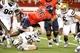 Nov 9, 2013; Tucson, AZ, USA; Arizona Wildcats running back Ka  Deem Carey (25) runs the ball as he is defended by UCLA Bruins inside linebacker Jordan Zumwalt (35) and inside linebacker Eric Kendricks (6) during the second quarter at Arizona Stadium. Mandatory Credit: Casey Sapio-USA TODAY Sports