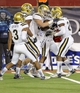 Nov 9, 2013; Tucson, AZ, USA; UCLA Bruins cornerback Ishmael Adams (24) is congratulated by his teammates after intercepting the ball during the fourth quarter against the Arizona Wildcats at Arizona Stadium. UCLA beat Arizona 31-26. Mandatory Credit: Casey Sapio-USA TODAY Sports
