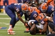 Nov 2, 2013; Syracuse, NY, USA; Syracuse Orange defenders Dyshawn Davis (35) and Marqez Hodge (33) and Jay Bromley (96) and Micah Robinson (93) make a tackle on Wake Forest Demon Deacons running back Josh D. Harris (25)   during the third quarter of a game at the Carrier Dome. Mandatory Credit: Mark Konezny-USA TODAY Sports