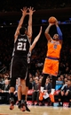 Nov 10, 2013; New York, NY, USA;  New York Knicks shooting guard J.R. Smith (8) shoots over San Antonio Spurs shooting guard Manu Ginobili (20) and power forward Tim Duncan (21) during the first quarter at Madison Square Garden. Mandatory Credit: Anthony Gruppuso-USA TODAY Sports