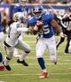 Nov 10, 2013; East Rutherford, NJ, USA; New York Giants running back Andre Brown (35) runs past Oakland Raiders cornerback Mike Jenkins (21) at MetLife Stadium. Mandatory Credit: Robert Deutsch-USA TODAY Sports