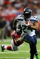 Nov 10, 2013; Atlanta, GA, USA; Seattle Seahawks running back Marshawn Lynch (24) breaks a tackle by Atlanta Falcons linebacker Paul Worrilow (55) during the second half at the Georgia Dome. The Seahawks defeated the Falcons 33-10. Mandatory Credit: Dale Zanine-USA TODAY Sports