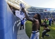 Nov 10, 2013; Chicago, IL, USA;  Detroit Lions free safety Louis Delmas (26) gives his shirt to a fan after the Lions beat the Bears 21-19 at Soldier Field. Mandatory Credit: Matt Marton-USA TODAY Sports