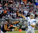 Nov 10, 2013; Chicago, IL, USA;  Detroit Lions quarterback Matthew Stafford (9) throws against Chicago Bears defensive tackle Stephen Paea (92)at Soldier Field. Mandatory Credit: Matt Marton-USA TODAY Sports