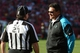 November 10, 2013; San Francisco, CA, USA; Carolina Panthers head coach Ron Rivera (right) talks to NFL head linesman John Schleyer (21) during the third quarter against the San Francisco 49ers at Candlestick Park. The Panthers defeated the 49ers 10-9. Mandatory Credit: Kyle Terada-USA TODAY Sports