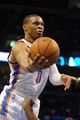 Nov 10, 2013; Oklahoma City, OK, USA; Oklahoma City Thunder point guard Russell Westbrook (0) attempts a shot against the Washington Wizards during the third quarter at Chesapeake Energy Arena. Mandatory Credit: Mark D. Smith-USA TODAY Sports