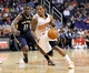 Nov 10, 2013; Phoenix, AZ, USA; Phoenix Suns point guard Eric Bledsoe (2) dribbles the ball under pressure from New Orleans Pelicans point guard Jrue Holiday (11) during the fourth quarter at US Airways Center. Mandatory Credit: Casey Sapio-USA TODAY Sports