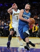 Nov 10, 2013; Los Angeles, CA, USA; Minnesota Timberwolves point guard J.J. Barea (11) drives to the basket past Los Angeles Lakers point guard Jordan Farmar (1) in the first half of the game at Staples Center. Mandatory Credit: Jayne Kamin-Oncea-USA TODAY Sports