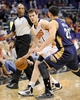 Nov 10, 2013; Phoenix, AZ, USA; Phoenix Suns point guard Goran Dragic (1) dribbles the ball under pressure from New Orleans Pelicans shooting guard Austin Rivers (25) during the second quarter at US Airways Center. Mandatory Credit: Casey Sapio-USA TODAY Sports