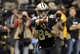 Nov 10, 2013; New Orleans, LA, USA; New Orleans Saints wide receiver Kenny Stills (84) pulls in a touchdown pass against the Dallas Cowboys during the fourth quarter at Mercedes-Benz Superdome. Mandatory Credit: John David Mercer-USA TODAY Sports