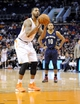 Nov 10, 2013; Phoenix, AZ, USA; Phoenix Suns power forward Markieff Morris (11) shoots a free throw during the second quarter against the New Orleans Pelicans at US Airways Center. The Suns beat the Pelicans 101-94. Mandatory Credit: Casey Sapio-USA TODAY Sports