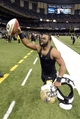 Nov 10, 2013; New Orleans, LA, USA; New Orleans Saints running back Mark Ingram (22) runs off the field with a presentation game ball following their 49-17 victory over the Dallas Cowboys at Mercedes-Benz Superdome. Mandatory Credit: John David Mercer-USA TODAY Sports