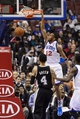 Nov 11, 2013; Philadelphia, PA, USA; Philadelphia 76ers guard Evan Turner (12) dunks during the third quarter against the San Antonio Spurs at Wells Fargo Center. The Spurs defeated the Sixers 109-85. Mandatory Credit: Howard Smith-USA TODAY Sports