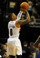 Nov 11, 2013; Portland, OR, USA; Portland Trail Blazers point guard Damian Lillard (0) shoots the ball during the first quarter against the Detroit Pistons at Moda Center. Mandatory Credit: Steve Dykes - USA TODAY Sports