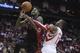 Nov 11, 2013; Houston, TX, USA; Toronto Raptors power forward Amir Johnson (15) is fouled by Houston Rockets center Dwight Howard (12) during the fourth quarter at Toyota Center. The Rockets won 110-104.  Mandatory Credit: Andrew Richardson-USA TODAY Sports