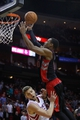 Nov 11, 2013; Houston, TX, USA; Toronto Raptors shooting guard DeMar DeRozan (10) shoots over Houston Rockets small forward Chandler Parsons (25) during the first overtime period at Toyota Center. Mandatory Credit: Andrew Richardson-USA TODAY Sports