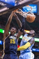 Nov 11, 2013; Salt Lake City, UT, USA; Utah Jazz power forward Derrick Favors (15) dunks while defended by Denver Nuggets power forward J.J. Hickson (7) during the second half at EnergySolutions Arena. Denver won 100-81. Mandatory Credit: Russ Isabella-USA TODAY Sports