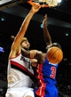 Nov 11, 2013; Portland, OR, USA; Portland Trail Blazers center Robin Lopez (42) dunks the ball on Detroit Pistons shooting guard Rodney Stuckey (3) during the third quarter of the game at Moda Center. The Blazers won the game 109-103. Mandatory Credit: Steve Dykes - USA TODAY Sports