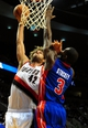 Nov 11, 2013; Portland, OR, USA; Portland Trail Blazers center Robin Lopez (42) goes up for a dunk on Detroit Pistons shooting guard Rodney Stuckey (3) during the third quarter of the game at Moda Center. The Blazers won the game 109-103. Mandatory Credit: Steve Dykes - USA TODAY Sports