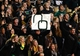 Nov 7, 2013; Waco, TX, USA; Baylor Bears fans hold a sign upside down of the Oklahoma Sooners logo during the game  at Floyd Casey Stadium. Baylor beat Oklahoma 41-12. Mandatory Credit: Tim Heitman-USA TODAY Sports