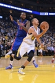 November 12, 2013; Oakland, CA, USA; Golden State Warriors point guard Stephen Curry (30, front) drives past Detroit Pistons power forward Greg Monroe (10) during the third quarter at Oracle Arena. The Warriors defeated the Pistons 113-95. Mandatory Credit: Kyle Terada-USA TODAY Sports