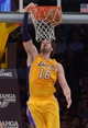 Nov 12, 2013; Los Angeles, CA, USA; Los Angeles Lakers forward Pau Gasol (16) dunks the ball against the New Orleans Pelicans at Staples Center. The Lakers defeated the Pelicans 116-95. Mandatory Credit: Kirby Lee-USA TODAY Sports