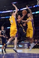 Nov 12, 2013; Los Angeles, CA, USA; New Orleans Pelicans guard Austin Rivers (25) is defended by Los Angeles Lakers forward Ryan Kelly (4) and center Robert Sacre (50) at Staples Center. The Lakers defeated the Pelicans 116-95. Mandatory Credit: Kirby Lee-USA TODAY Sports