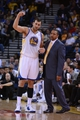 November 12, 2013; Oakland, CA, USA; Golden State Warriors center Andrew Bogut (12) talks to head coach Mark Jackson (right) against the Detroit Pistons during the third quarter at Oracle Arena. The Warriors defeated the Pistons 113-95. Mandatory Credit: Kyle Terada-USA TODAY Sports