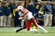 Nov 9, 2013; Ann Arbor, MI, USA; Nebraska Cornhuskers wide receiver Kenny Bell (80) is tackled by Michigan Wolverines defensive back Raymon Taylor (6) at Michigan Stadium. Mandatory Credit: Rick Osentoski-USA TODAY Sports