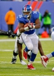 Nov 10, 2013; East Rutherford, NJ, USA;  New York Giants running back Andre Brown (35) protects the ball during the second half against the Oakland Raiders at MetLife Stadium. New York Giants defeat the Oakland Raiders 24-20. Mandatory Credit: Jim O'Connor-USA TODAY Sports