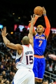Nov 13, 2013; Atlanta, GA, USA; New York Knicks small forward Carmelo Anthony (7) shoots a three over Atlanta Hawks center Al Horford (15) in the first quarter at Philips Arena. Mandatory Credit: Daniel Shirey-USA TODAY Sports